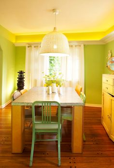 It is interesting how they brought down the crown molding and used it for lights. And love the bright green.