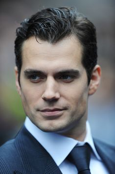 Henry cavill is so hot, he would have been great as the main character christian in fifty shades of grey, he looks exactly like Jamie dornan