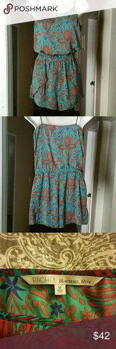 """Adorable Rachel Roy romper EUC! This silky feel floral print romper is in excellent condition. It has adjustable straps and an elastic waistband for comfort and ease. Pair this with strappy sandals and your ready for summer! Across chest 17.5"""", under armpit to waistband 10"""", rise 11"""". Size: medium. Teal green, red, purple Rachel Roy Other"""