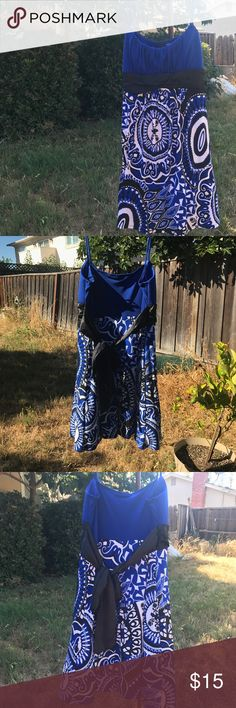 Blue Patterned Dress This is a super cute dress with a blue top, a black tie and a blue/black/white bottom. The layer underneath has some tulle to make the bottom flare out. Worn twice, in excellent condition. love tease Dresses Midi