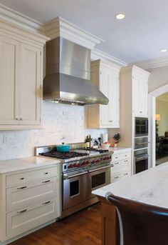 A six-burner Wolf #stove encompasses one work zone in the Black's #kitchen. #interior #design