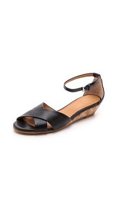 Tapered leather straps crisscross the open toe on timeless Marc by Marc Jacobs sandals. A buckle secures the ankle strap, and a low cork wedge offers easy lift. Rubber sole. Leather: Cowhide. Imported, China. This item cannot be gift-boxed. Measurements Heel: 1.25in / 30mm