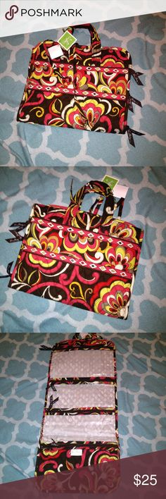 NWT Vera Bradley Villa Organizer NWT Vera Bradley hanging Villa organizer 26' in length and 11' in width, folds up, ties, four zip compartment, great for traveling or as a gift. ask any questing before purchasing, price reflect condition Vera Bradley Bags