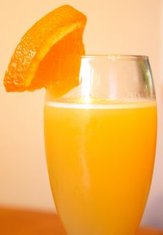 Amaretto Fizz Punch! - Great for parties! 2 and 1/2 Cups Amaretto Liqueur (21 oz) 3 and 1/2 Cups Orange Juice (28oz) 3 and 1/2 Cups of Sprite (28oz) 1 and 3/4 Cups of Sweet and Sour Mix (14oz) As much or as little orange sherbet as you like. Pour ingredients into a punch bowl. Allow the sherbet to melt slightly into the punch. Serves 14.