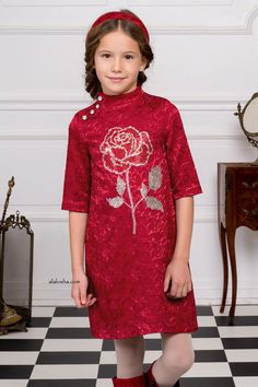 Girls red, dress by Love Made Love. Made from a soft textured, cotton blend jacquard with a pretty shimmery paisley pattern and a smooth cotton lining.