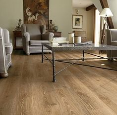 These laminate wood floors from the Tarkett Woodstock collection exude rustic country charm. Laminate wood floors give warmth to any room in your home at a price you can afford.