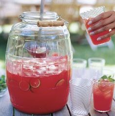 Watermelon Agua Fresca ~ 1 very ripe, red seedless watermelon, about 12 lb. Juice of 4 limes 3/4 cup sugar 1 cup crushed fresh mint leaves, plus sprigs for garnish 4 cups sparkling water 3 limes, thinly sliced 2 quarts ice cubes