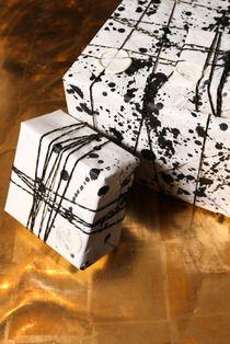 .Splatter gift wrap--easy to do.
