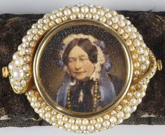 This bracelet, set with a circular miniature of Queen Victoria's mother, Victoria, Duchess of Kent, within a pearl oroborous symbolising eternal love and mourning was designed by Prince Albert following the death of the Duchess of Kent in March 1861. It was completed after Prince Albert's own death in December 1861. The portrait of the Duchess is a hand-coloured photograph of around 1859 selected by Prince Albert. Engraved: Last gift / from my / beloved & adored Albert / ordered by him / for…