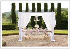 chandelier, candelabras, lucite chairs, draping