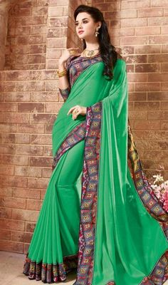 An instant mood brightener in this sari, georgette fabric in bottle green color would be a perfect choice for any occasion. The ethnic lace work to your clothing adds a sign of splendor statement for the look.  #indiansarees #indianlooksari #fancywomensaree