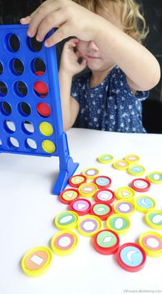 Easy to modify shape sorting and patterning idea with the connect 4 game. fine motor skills while learning shapes! Great for toddlers and preschoolers.