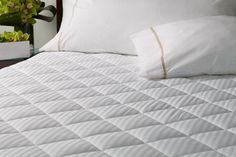 """Westin Home Collection - Heavenly Mattress Pad. Protect your sleep investment. Pillow-soft, luxe 400 count sateen stripe with water and stain resistant finish. Fitted elastic edges for secure fit. 18"""" deep. Cotton"""