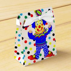 A cute juggling circus clown sitting on a brightly colored polka dot white favor box. Ideal for kids parties, don't forget to personalize the text with your details. #polka-dot #spots #colorful #circus-theme #circus #circus-clown #clown #clowns #juggling-clown #happy-clown #cheerful #happy #kids-party-favors #cute-pictures #bright #fun #smiley-faced-clown #red #blue