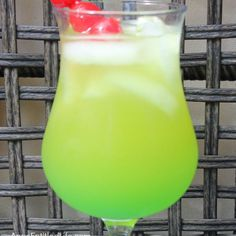 High Tide Cocktail Recipe Beverages, Cocktails with rum, liquor, midori, pineapple juice, ice, blue curaçao, cocktail cherries