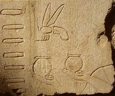 Egyptian hieroglyph showing the hive tubes, the bee. Honey was used in ancient Egypt as a medicine.