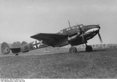 Bf 110 aircraft of German Zerstörergeschwader (Destroyer Wing) 76 preparing for flight, Western Europe, May 1940; note shark mouth marking.
