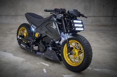 http://s1.cdn.autoevolution.com/images/news/gallery/honda-grom-turns-into-a-spectacular-streetfighter-photo-gallery_8.jpg