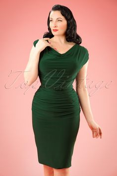 Feel like a glamorous bombshell in this 50s Billie Pencil Dress!This stunner looks like she came straight out of Marilyn Monroe's closet... she would have worn her proudly ;-) The stunning, draped top gives Billie the perfect amount of 'vavavoom' and thanks to the side pleats you can also feel that way; they not only ensure a dazzling look but they make her also very flattering. The belt finishes off your breath-taking, feminine silhouette completely. Made from a fantasti...