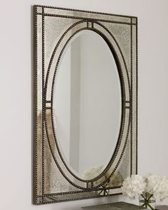 """""""Ernestine"""" Mirror at Horchow.  $460      Oval mirror with antiqued mirror frame is outlined with beaded borders for a more defined look. Imported.  Center mirror has a wide 1.25"""" bevel.  Beaded framework has a heavily antiqued silver-champagne finish with a dark gray glaze.  28""""W x 1""""D x 44""""T."""