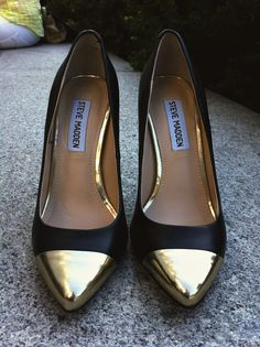 gold toed shoes.