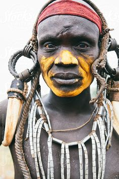 Mursi tribe man portrait with traditional clothes. Mago National park, Ethiopia, Africa by Alejandro Moreno de Carlos for Stocksy United
