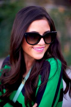 Emerald with navy and dark shades to compliment her lovely dark locks
