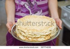 """Cake """"Napoleon"""" on a tray in the hands of women. - stock photo"""