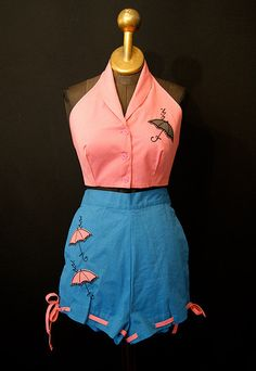 Super adorable 1950s two-piece umbrella adorned summer shorts and halter top set. #vintage #1950s #playsuits #summer #fashion