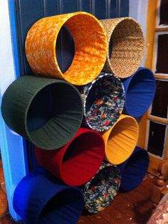 Recycled cardboard fabric tubes turned yarn shelves. (ask someone who does upholstery if they have any they don't need)