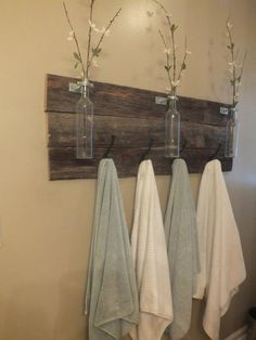 Reclaimed Wooden Towel Rack w/ Bottle Holders on Etsy, $75.00
