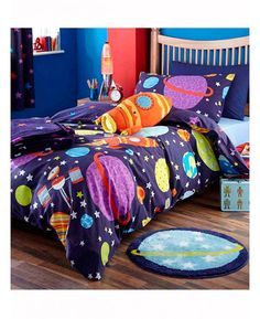This Catherine Lansfield Outer Space Single Duvet Cover Set features rockets, planets, stars and satellites on a dark blue background.