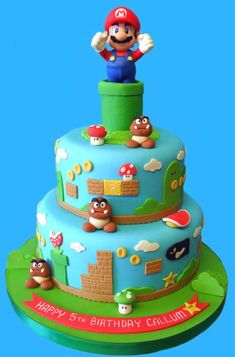 Beware of goombas, bullets and turtle shells! This cakebrings back the nostalgia of playing the original Super MarioBrothers. The topper for this cake is a 5 inch tall Mario figurewhich can be kept and played with long after this cake has beeneaten. Luigi Cake, Mario Kart Cake, Mario Bros Cake, Bolo Do Mario, Bolo Super Mario, Mario Bros., Mario Birthday Cake, Super Mario Birthday, 5th Birthday