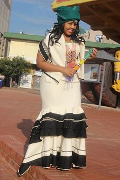 We have the latest modern Xhosa dresses online on Sunika. Discover Top Xhosa dresses designers in South Africa for your next outstanding Xhosa Wedding dress. African Dresses Men, African Fashion Ankara, Latest African Fashion Dresses, African Print Fashion, African Attire, African Wear, African Clothes, South African Traditional Dresses, Traditional Dresses Designs