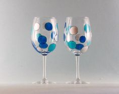 Hand Painted Wine Glasses with Cherry Blossoms. Gorgeous Blooms offered in four pastel colors fill these lovely Hand Painted Wine Glasses. Featured in a variety of colors, together these painted Floral Wine Glasses create a colorful Spring display. They are Simply Beautiful! Each 11 oz Hand Painted Wine Glass you order is hand painted by me and in most cases painted per order so personalizing is welcome. They are dishwasher safe, microwave safe and the personalizing is free. You can be sure…