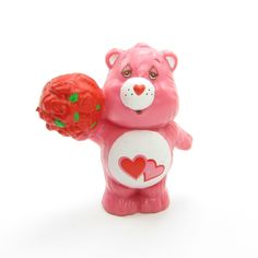 "This vintage Care Bears PVC miniature figurine is ""Love-A-Lot-Bear Offering a Bunch of Roses."" Love-A-Lot Bear is pink with two pink hearts on her tummy and she has a sweet expression on her face as s"