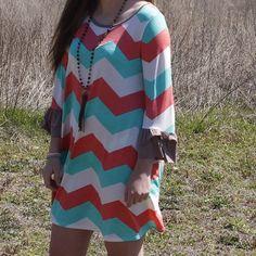Very cute Chevron dress Coral and mint chevron print dress with ruffle sleeves Dresses Mini