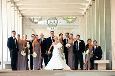 Long gray dresses, tuxes; also bmaid bouquets