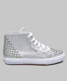 Feet will dazzle the eyes of onlookers every time they step out in these shiny sneakers. A glittery metallic finish with stud accents adds touches of girlish glamour with a little alternative edge, while the lace-up design offers a secure fit and classic sneaker style.