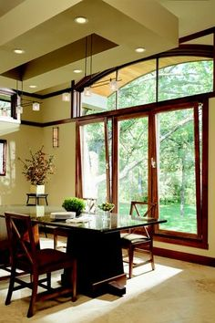 Contemporary Dining Room with Wall sconce, Marvin Tilt and Turn, Chandelier, Marvin Special Shape Round Top, Arched window