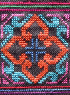Akha cross stitch detail
