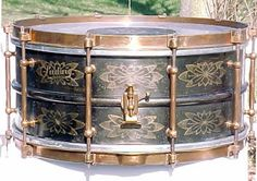 1920 Ludwig Black Beauty snare drum snare drum featuring a 6.25x14 flower engraved heavy brass shell, brass clips and rims and 8 tube lugs.