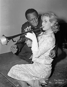 Jeanne Moreau and Miles Davis during the recording of the soundtrack for the film: Ascenseur pour l'échafaud. (1958) by Louis Malle
