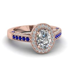 Beguiling Halo Ring Oval Shaped Diamond Halo Ring With Blue Sapphire In 18K  Rose Gold 5b342cf2a255