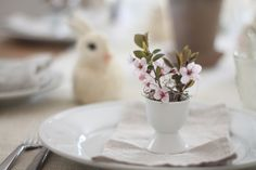 flowers nested in egg cups for easy DIY Easter place settings