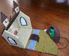 Amazing fabric castle made according to this tutorial http://uklassinus.blogspot.co.uk/2008/08/fabric-dollhouse-tutorial.html