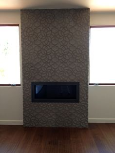 Artistic Tile | Designed by Stones Unlimited in San Diego | Ziva Lotus Gris fireplace from the hand carved collection