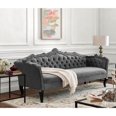 - Info - Features - Dimensions The classically elegant Brooklyn grey velvet sofa boasts a marvelous hand carved frame design and individually hand-applied silver nail head trim. The luxurious button t