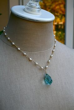 Faceted Aqua and Pearl Necklace: Beautiful faceted aqua quartz briolette hangs lightly beneath fresh water pearls that are hand wrapped with 14k gold filled wire and finished with a 14k gold filled lobster clasp. Approx length 18 1/2""