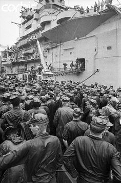 Da Nang, Vietnam 1969 - More than 1,000 troops of the Marine Division's 3rd regiment stand in the rain waiting their turn to board the USS Iwo Jima to return to the US. The leathernecks are part of some 7,000 leaving Vietnam under President Nixon's 'second phase' pullout. --- Image by © Bettmann/CORBIS.